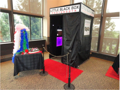 The enclosed booth you can rent from Little Black Box Photobooth.