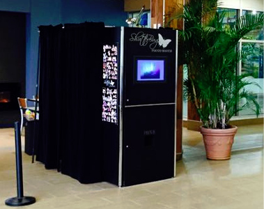 The enclosed booth you can rent from ShutterBug Photo Booth Rentals.
